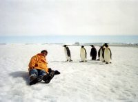 Terry with Emperor Penguins on Amery Ice Shelf